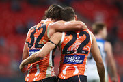 Josh Kelly of the Giants (R) celebrates with Ryan Griffen of the Giants (L) after kicking a goal during the round 12 AFL match between the Greater Western Sydney Giants and the Gold Coast Suns at Spotless Stadium on June 9, 2018 in Sydney, Australia.