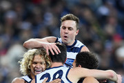 Jack Henry of the Cats is congratulated by team mates after kicking a goal during the round 18 AFL match between the Geelong Cats and the Melbourne Demons at GMHBA Stadium on July 21, 2018 in Geelong, Australia.