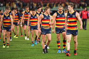 (L-R) Rory Sloane of the Crows, Taylor Walker of the Crows and Josh Jenkins of the Crows walk from the ground during the round 19 AFL match between the Adelaide Crows and the Melbourne Demons at Adelaide Oval on July 28, 2018 in Adelaide, Australia.