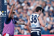 Jack Henry of the Cats recovers after colliding with the goalpost during the 2018 AFL round 19 match between the Geelong Cats and the Brisbane Lions at GMHBA Stadium on July 28, 2018 in Geelong, Australia.