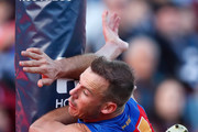 Jack Henry of the Cats and Josh Walker of the Lions collide with the goalpost in a marking contest during the 2018 AFL round 19 match between the Geelong Cats and the Brisbane Lions at GMHBA Stadium on July 28, 2018 in Geelong, Australia.