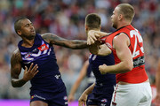 Bradley Hill of the Dockers argues with Alex Morgan of the Bombers during the round two AFL match between the Fremantle Dockers and the Essendon Bombers at Optus Stadium on March 31, 2018 in Perth, Australia.