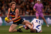 Rory Sloane of the Crows is tackled by Jack Ziebell of the Kangaroos during the 2018 AFL round 22 match between the Adelaide Crows and the North Melbourne Kangaroos at Adelaide Oval on August 19, 2018 in Adelaide, Australia.