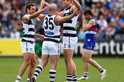 Steven Motlop, Paul Chapman and Tom Hawkins of the Cats celebrate a goal during the round 22 AFL match between the Geelong Cats and the Western Bulldogs at Simonds Stadium on August 26, 2012 in Geelong, Australia.