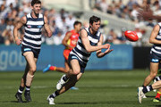 Jack Henry of the Cats handballs during the round 23 AFL match between the Geelong Cats and the Gold Coast Suns at GMHBA Stadium on August 25, 2018 in Geelong, Australia.