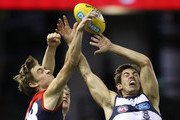 Tim Smith of the Demons and Daniel Menzel of the Cats compete for the ball  during the round three AFL match between the Geelong Cats and the Melbourne Demons at Etihad Stadium on April 8, 2017 in Melbourne, Australia.