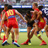 Tom Lynch Photos - Tom Lynch of the Suns gets tackled by Michael Walters and Alex Pearce of the Dockers during the round three AFL match between the Gold Coast Suns and the Fremantle Dockers at Optus Stadium on April 7, 2018 in Perth, Australia. - AFL Rd 3 - Gold Coast v Fremantle