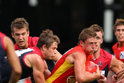 Daniel Harris of the Suns is tackled during the round four AFL match between the Gold Coast Suns and the Melbourne Demons at The Gabba on April 17, 2011 in Brisbane, Australia.