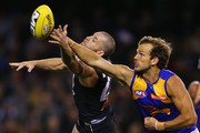 Will Schofield (R) of the Eagles and Heath Scotland of the Blues contest the ball during the round six AFL match between the Carlton Blues and the West Coast Eagles at Etihad Stadium on April 26, 2014 in Melbourne, Australia.