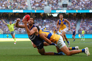Alex Pearce of the Dockers gets his handball away while being tackled by Josh Kennedy of the Eagles during the Round 6 AFL match between the Fremantle Dockers and West Coast Eagles at Optus Stadium on April 29, 2018 in Perth, Australia.