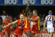 Liam Patrick, Gary Ablett and Daniel Harris of the Suns celebrate a goal by Liam Patrick during the round seven AFL match between the Gold Coast Suns and the Brisbane Lions at The Gabba on May 7, 2011 in Brisbane, Australia.
