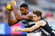 Josh Thomas of the Magpies tackles Esava Ratugolea of the Cats during the round eight AFL match between the Collingwood Magpies and the Geelong Cats at Melbourne Cricket Ground on May 13, 2018 in Melbourne, Australia.