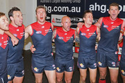 Matt Jones, Cameron Pedersen, Tom McDonald, Nathan Jones, Jack Grimes and Jake Spencer of the Demons sing the song in the rooms after winning the round eight AFL match between the Melbourne Demons and the Western Bulldogs at Melbourne Cricket Ground on May 24, 2015 in Melbourne, Australia.