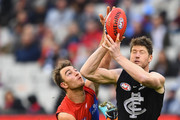 Tim Smith of the Demons and Sam Rowe of the Blues compete for a mark during the round nine AFL match between the Carlton Blues and the Melbourne Demons at Melbourne Cricket Ground on May 20, 2018 in Melbourne, Australia.