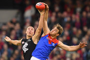 Harry McKay of the Blues and Tim Smith of the Demons compete in the ruck during the round nine AFL match between the Carlton Blues and the Melbourne Demons at Melbourne Cricket Ground on May 20, 2018 in Melbourne, Australia.