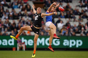 Harry McKay of the Blues and Tim Smith of the Demons compete for the ball during the 2018 AFL round nine match between the Carlton Blues and the Melbourne Demons at the Melbourne Cricket Ground on May 20, 2018 in Melbourne, Australia.
