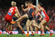 Josh Kelly of the Giants has his kick smothered by Isaac Heeney of the Swans and reacts injures his leg during the AFL Second Elimination Final match between the Sydney Swans and the GWS Giants at Sydney Cricket Ground on September 8, 2018 in Sydney, Australia.