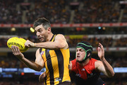 Ricky Henderson of the Hawks handballs whilst being tackled by Angus Brayshaw of the Demons during the AFL Semi Final match between the Hawthorn Hawks and the Melbourne Demons at the Melbourne Cricket Ground on September 14, 2018 in Melbourne, Australia.