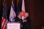 Former Mayor of New York City, Presenter Michael Bloomberg and Honoree, 2015 AFMDA Humanitarian Award Ronald O. Perelman speak on stage during AFMDA Red Star Gala at The Grand Hyatt New York on December 2, 2015 in New York City.