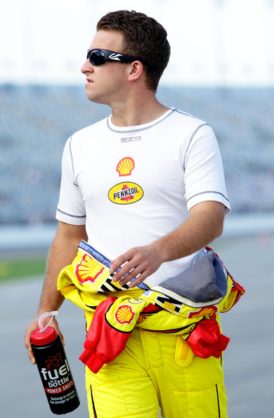 AJ Allmendinger, driver of the #22 Shell/Pennzoil Dodge, walks on the grid during qualifying for the NASCAR Sprint Cup Series Coke Zero 400 Powered by Coca-Cola at Daytona International Speedway on July 6, 2012 in Daytona Beach, Florida. (July 5, 2012 - Source: Sean Gardner/Getty Images North America)