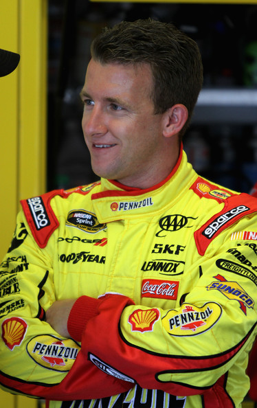 AJ Allmendinger, driver of the #22 Shell/Pennzoil Dodge, stands in the garage during practice for the NASCAR Sprint Cup Series Coke Zero 400 Powered by Coca-Cola at Daytona International Speedway on July 5, 2012 in Daytona Beach, Florida. (July 4, 2012 - Source: Jerry Markland/Getty Images North America)