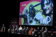 (L-R) Chris Harwick, Angela Kang, Scott Gimple, Robert Kirkman, Dave Alpert, Norman Reedus, Jeffrey Dean Morgan, Danai Gurira, Cailey Fleming, Josh McDermitt, Seth Gilliam, and Ross Marquand speak onstage during a panel for AMC's The Walking Dead Universe including AMC's flagship series and the untitled new third series within The Walking Dead franchise at Hulu Theater at Madison Square Garden on October 05, 2019 in New York City.