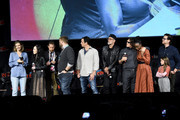 (L-R) Lauren Cohan, Angela Kang, Scott Gimple, Robert Kirkman, Dave Alpert, Jeffrey Dean Morgan, Norman Reedus, Danai Gurira, Cailey Fleming, and Josh McDermitt speak onstage during a panel for AMC's The Walking Dead Universe including AMC's flagship series and the untitled new third series within The Walking Dead franchise at Hulu Theater at Madison Square Garden on October 05, 2019 in New York City.