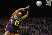 Anna Scarlett of the Mystics competes with Irene van Dyk of the Magic during the ANZ Championship preliminary final match between the Waikato Bay of Plenty Magic and the Mystics at Mystery Creek Events Centre on May 15, 2011 in Hamilton, New Zealand.