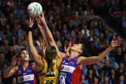 Kayla Cullen and Anna Scarlett of the Mystics defends against Irene van Dyk of the Magic during the ANZ Championship preliminary final match between the Waikato Bay of Plenty Magic and the Mystics at Mystery Creek Events Centre on May 15, 2011 in Hamilton, New Zealand.