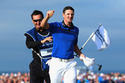 Justin Rose of England celebrates on the 18th green with his caddie Mark Fulcher after winning the Aberdeen Asset Management Scottish Open at Royal Aberdeen on July 13, 2014 in Aberdeen, Scotland.
