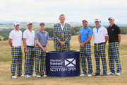 (L-R) Marc Warren of Scotland, Kevin Chappell of the USA, Russell Knox of Scotland, Doddie Weir (former Scotland rugby player), David Howell of England, Stephen Gallacher of Scotland and Martin Laird of Scotland  pose for a photograph on Tartan Wednesday during the Pro Am event prior to the start of the Aberdeen Standard Investments Scottish Open at Gullane Golf Course on July 11, 2018 in Gullane, Scotland.