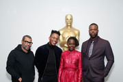 (L-R) Director Jordan Peele, moderator KC Ifeanyi and actors Lupita Nyong'o and Winston Duke attend The Academy of Motion Picture Arts and Sciences official screening of Us at the MoMA Celeste Bartos Theater on March 18, 2019 in New York City.