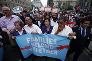 """(L-R) U.S. Rep. Joseph Crowley (D-NY), Rep. Jan Schakowsky (D-IL), Rep. Luis Gutierrez (D-IL), Rep. John Lewis (D-GA), Rep. Judy Chu (D-CA) and Rep. Jimmy Gomez (D-CA) march to the headquarters of U.S. Customs and Border Protection during a protest June 13, 2018 in Washington, DC. Democratic congressional members joined actives to protest """"the Trump administration's policy to separate children from their parents at the border."""""""