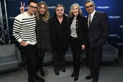 Actors Dan Levy, Annie Murphy, Catherine O'Hara and Eugene Levy pose for a photo with host Ron Bennington (C) during a visit the SiriusXM Studios on February 6, 2017 in New York City.