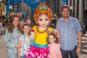 In this handout photo provided by Disneyland Resort, actress Alyson Hannigan poses with her daughter Satyana, Disney Junior star Fancy Nancy, daughter Keeva and husband Alexis Denisof, after a welcome ceremony for the character who meets guests daily on May 3, 2019 at Disney California Adventure Park in Anaheim, California. Hannigan voices Fancy Nancys mom, Claire, in the animated family comedy Fancy Nancy airing on Disney Channel, Disney Junior and the DisneyNow app.