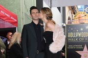 Recording artist Adam Levine (L) and wife model Behati Prinsloo kiss after he is honored with a Star on the Hollywood Walk of Fame in Hollywood, California, on February 10, 2017. / AFP / Mark RALSTON