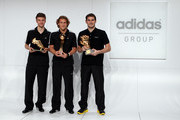 (L-R) Thomas Mueller, adidas Golden Boot Winner, Diego Forlan, adidas Golden Ball Winner and Iker Casillas, adidas Golden Glove Winner pose with their FIFA 2010 World Cup adidas Golden Awards during the award ceremony at the adidas headquarters on December 14, 2010 in Herzogenaurach, Germany.