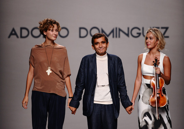 One of Spain's leading fashion designers Adolfo Dominguez (C) acknowledges the public at the end of the Adolfo Dominguez fashion show during the Cibeles Madrid Fashion Week Spring/Summer 2011 at the Ifema on September 19, 2010 in Madrid, Spain.