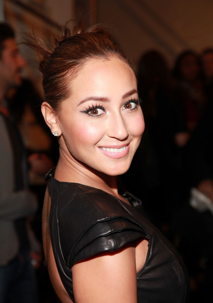 Singer Adrienne Bailon poses backstage at the Mackage Fall 2011 fashion show