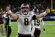Trevor Knight #8 of the Texas A&M Aggies celebrates after throwing a touchdown pass to Josh Reynolds #11 in the fourth quarter Kansas State Wildcats during the AdvoCare V100 Texas Bowl on December 28, 2016 in Houston, Texas.