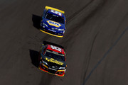 Clint Bowyer, driver of the #15 5-hour ENERGY Toyota, leads Martin Truex Jr., driver of the #56 NAPA Auto Parts Toyota, during the NASCAR Sprint Cup Series AdvoCare 500 at Phoenix International Raceway on November 10, 2013 in Avondale, Arizona.