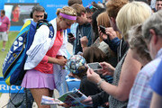 Sabine Lisicki of Germany signs autographs after her win over Magdalena Rybarikova of Slovakia on day four of the Aegon Classic at Edgbaston Priory Club on June 18, 2015 in Birmingham, England.