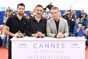 """(L-R) Actor Dogu Demirkol, director Nuri Bilge Ceylan, and Murat Cemcir attend """"Ahlat Agaci"""" Photocall during the 71st annual Cannes Film Festival at Palais des Festivals on May 19, 2018 in Cannes, France."""