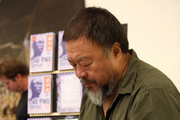 Chinese dissident artist Ai Weiwei signs books for fans after a panel discussion at the Berlin International Literature Festival on September 2, 2015 in Berlin, Germany. Ai and poet Liao Yiwu participated in a conversation about literature, contemporary art, and their relationships with Chinese authorities. Liao had been imprisoned for four years in 1989, and in 2011, Ai was detained and beaten by security officials and then imprisoned for 81 days, only to reclaim his passport this past July, after which he went to Germany to meet his his partner Wang Fen and their son Ai Lao.