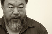 Image was processed using digital filters.) Chinese dissident artist Ai Weiwei pauses as he signs books for fans after a panel discussion at the Berlin International Literature Festival on September 2, 2015 in Berlin, Germany. Ai and poet Liao Yiwu participated in a conversation about literature, contemporary art, and their relationships with Chinese authorities. Liao had been imprisoned for four years in 1989, and in 2011, Ai was detained and beaten by security officials and then imprisoned for 81 days, only to reclaim his passport this past July, after which he went to Germany to meet his his partner Wang Fen and their son Ai Lao.