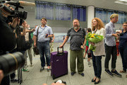 Chinese dissident artist Ai Weiwei is greeted by Parliamentary leader of the Bavarian Green Party Margarete Bause upon his arrival at Munich Airport on July 30, 2015 in Munich, Germany. This is his first trip abroad since Chinese authorities put him under house arrest in 2011 and confiscated his passport without charging him with any crime. They recently returned his passport, enabling Ai Weiwei to travel to see his son, who lives in Berlin. His 6-month UK visa application, however, has been rejected because the artist failed to mention any convictions, although he has been granted a 20-day visa to attend the opening of his show in London in September.