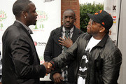 Recording Artist, Akon, VP DefJam Bu Thiam and Outkast's Big Boi at South Cobb High School to give turkeys to families in need on November 24, 2009 in Austell, Georgia.