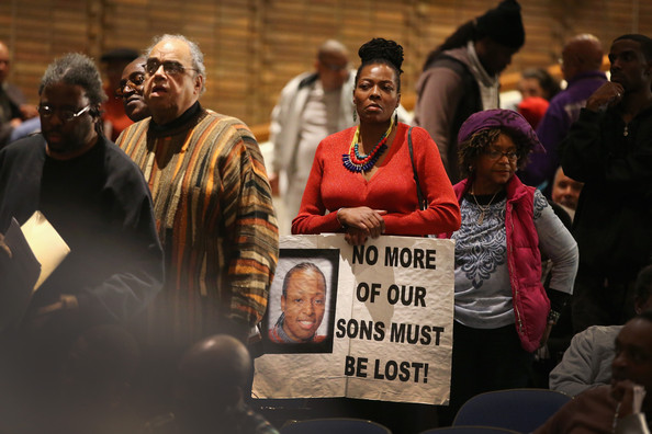 Guests listen to speakers at a town hall style meeting hosted by Rev. Al Sharpton to address gun violence that is plaguing many of the city's African American neighborhoods on December 19, 2013 in Chicago, Illinois. Of the nearly 1000 murders in Chicago in the past two year about 80 percent have been black men.