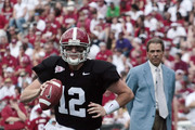 Quarterback Greg McElroy #12 of the University of Alabama looks for a receiver as coach Nick Saban looks on during the Alabama spring game at Bryant Denny Stadium on April 17, 2010 in Tuscaloosa, Alabama.