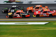 Kyle Busch, driver of the #54 Monster energy Toyota, races Ty Dillon, driver of the #3 Bass Pro Shops Chevrolet, during the NASCAR XFINITY Series Alert Today Florida 300 at Daytona International Speedway on February 21, 2015 in Daytona Beach, Florida.